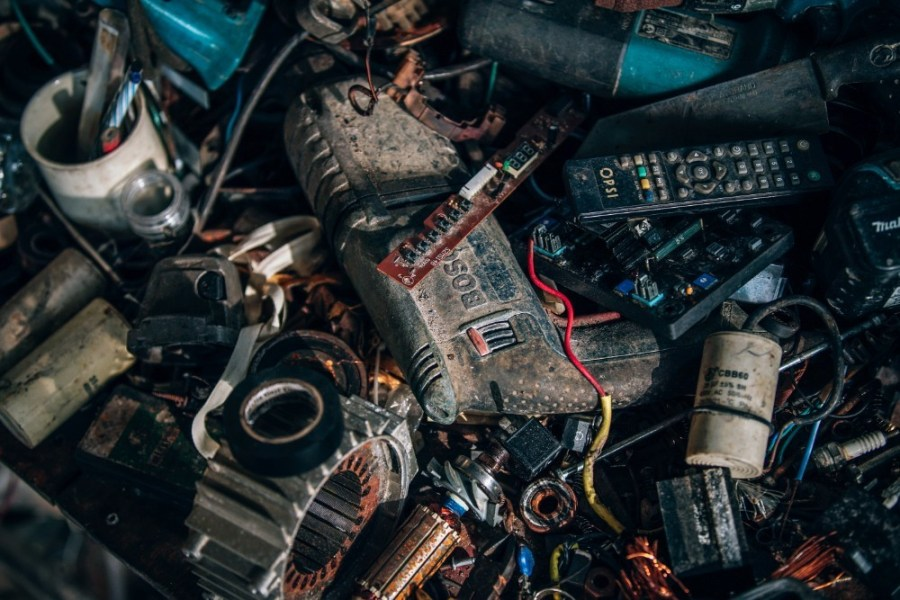 Messy-Power-Tools-Batteries-and-Remote-Controllers-on-a-Table