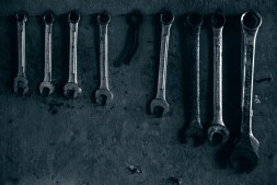 Metal-Wrenches-Hanging-on-the-Wall-in-Low-Light