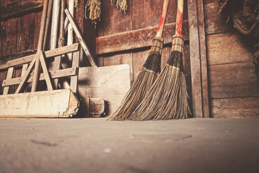 Old-Brooms-Placed-next-to-a-Wooden-Wall