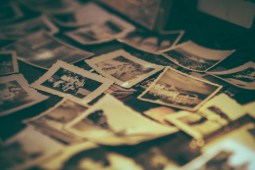 Old-Family-Photos-in-Black-and-White-Stacked-on-a-Table