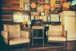 Retro-Living-Room-with-Two-Chairs-and-Beverage-Posters-on-the-Wall-behind-them