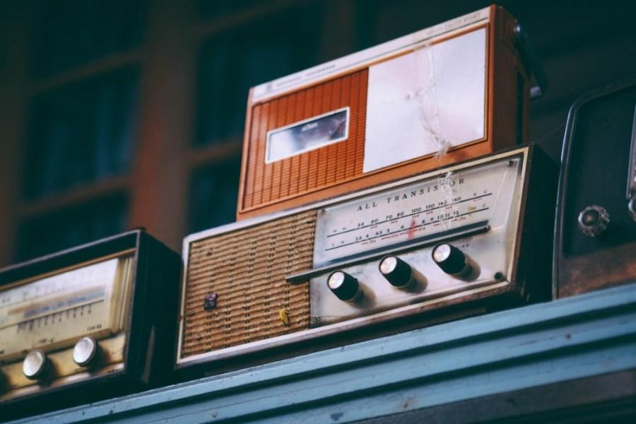 Vintage-Radios-Placed-on-a-Blue-Shelf