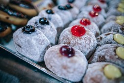 Close-up-Shot-of-Powdered-Sugar-Donuts-with-Jelly-on-Top