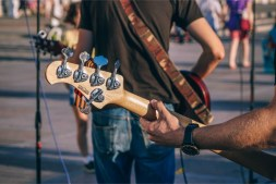 Close-up-Shot-of-a-Man-Playing-a-Handmade-Guitar