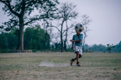 Nepali-Boy-Kicking-a-Ball-towards-the-Camera