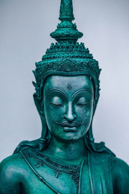 Teal-Buddhist-Warrior-Statue-with-a-Mustache