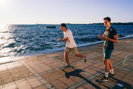 Two-Young-Men-Skating-on-the-Promenade-in-Sevastopol