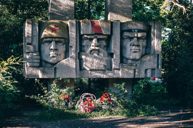 USSR-Statue-with-Flowers-in-front-of-it