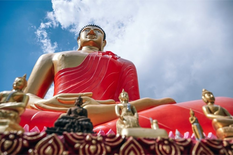 Upwards-View-of-a-Big-Buddha-Statue-with-Other-Small-Buddha-Statues-in-front
