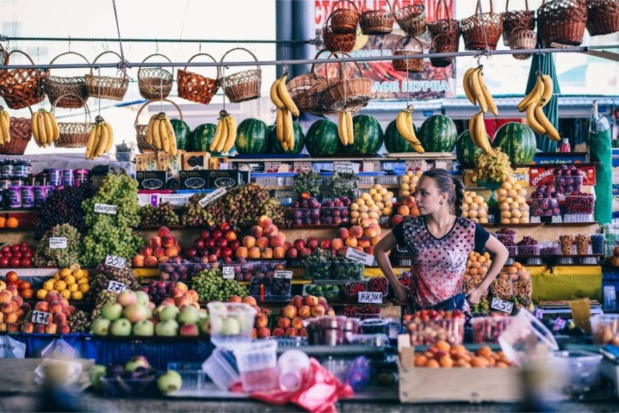 Young-Girl-Selling-Fruit-at-the-Farmers-Market
