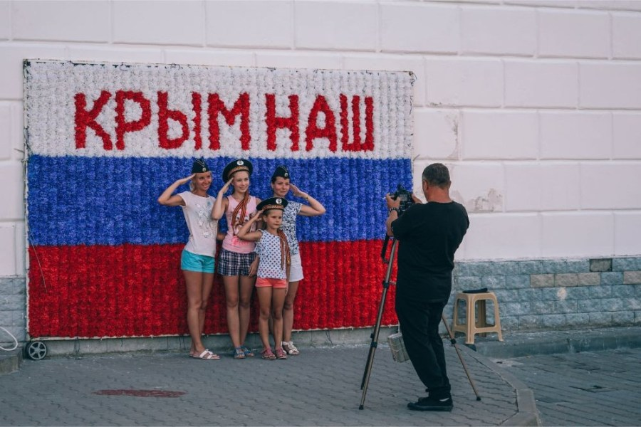 """Young-Girls-Taking-a-Picture-in-front-of-a-""""Crimea-is-ours""""-Sign"""