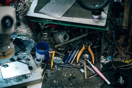 Messy-Desk-in-a-Mobile-Repair-Shop