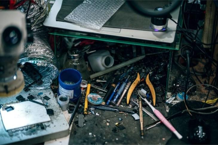 Messy-Desk-in-a-Mobile-Repair-Shop