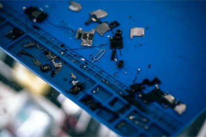 Spare-Smartphone-Pieces-on-a-Blue-Table