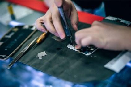 Woman-Repairing-a-Smartphone