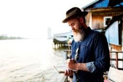 man journal exploring tourism concept PLYFS