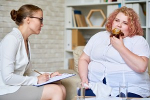 obese woman consulting about eating disorder stgrvm