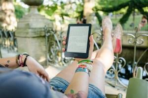 woman reading an ebook outside