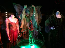 The Sanderson sisters' costumes, cauldron, and the stone statue of Winifred