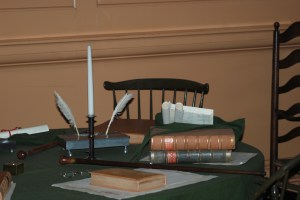 Old writing tools, old books and a table