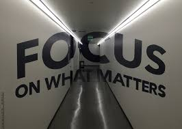 The words: Focus on what matters and a corridor