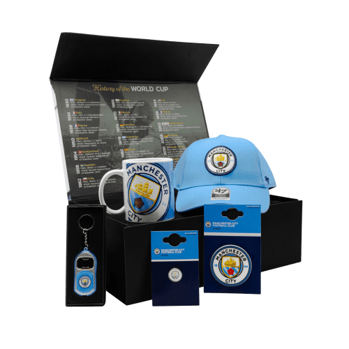 The Man City Supporters 1894 Chest gift box with a cap, mug, pin, magnet, and bottle opener.