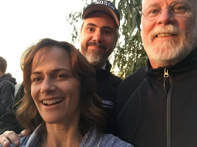 Sarah Clarke (left) on Bosch season 3 set with producer Henrik Bastin (middle) and creator Michael Connelly (right)
