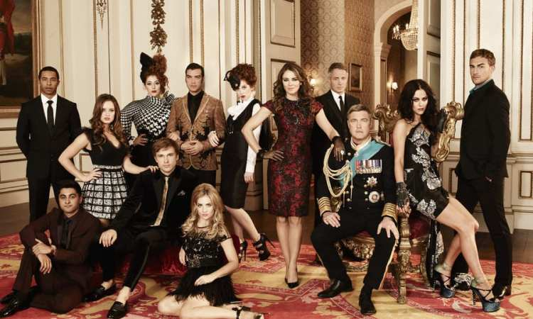 THE ROYALS -- Season: 1 -- Pictured: (l-r) Manpreet Bachu as Ashok, Ukweli Roach as Marcus, Merritt Patterson as Ophelia, William Moseley as Prince Liam, Lydia Rose Bewley as Penelope, Jake Maskall as Cyrus, Sophie Colquhoun as Gemma, Hatty Preston as Maribel, Elizabeth Hurley as Queen Helena, Oliver Milburn as Ted, Vincent Regan as King Simon, Alexandra Park as Princess Eleanor, Tom Austen as Jasper --