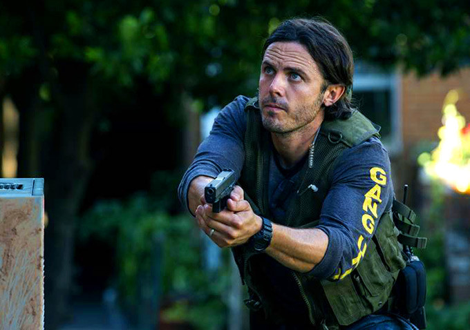 Casey Affleck as police officer with handgun in Triple 9