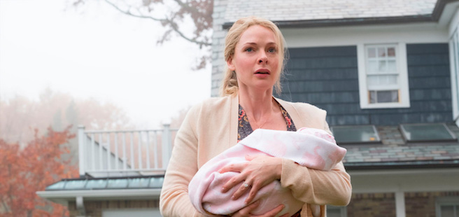Rebecca Ferguson holding a baby in The Girl on the Train