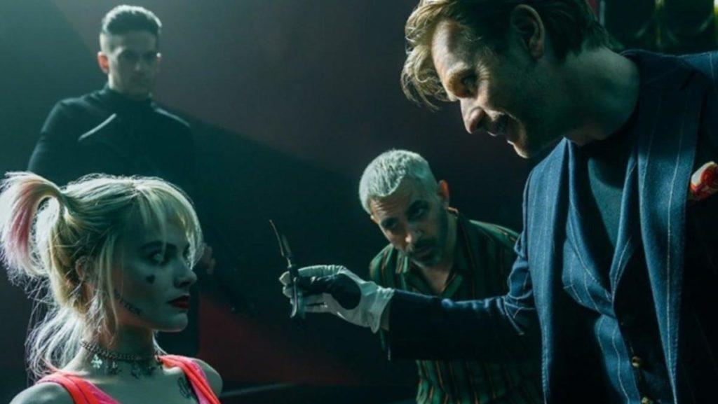 Ewan McGregor holding knife to Margot Robbie/Harley Quinn in Birds of Prey.