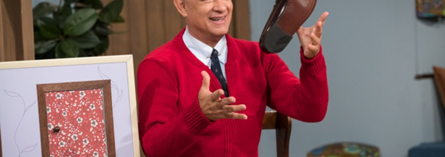 tom hanks as mr. rogers changing shoes in a beautiful day in the neighborhood