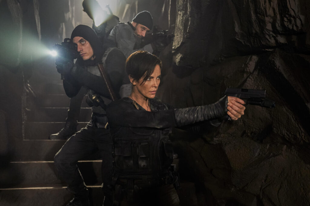 the old guard charlize theron holding gun