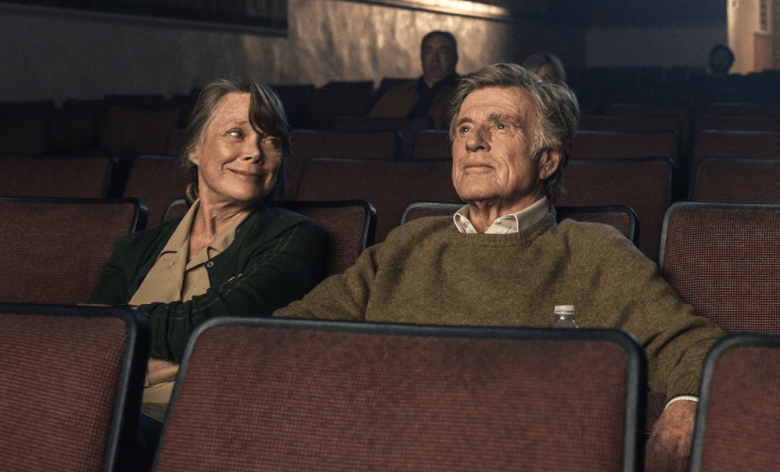 Sissy Spacek and Robert Redford sitting in movie theater for The Old Man and the Gun