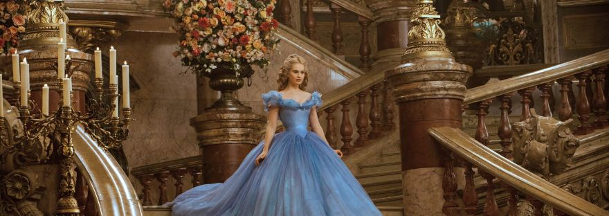 Cinderella (Lilly James) on the steps of the palace