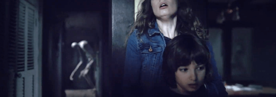 Gillian Jacobs and child with monster in Come Play
