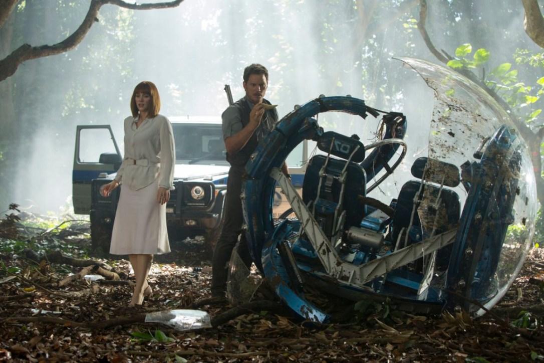Chris Pratt and Bryce Dallas Howard investigating broken vehicle in Jurassic World