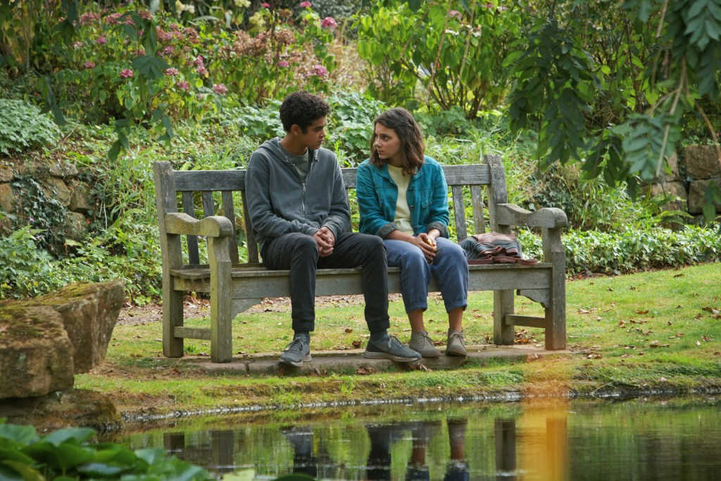 His Dark Materials - Will and Lyra sitting on a bench