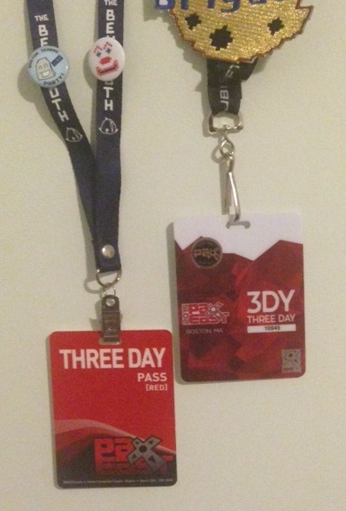 My badges from the first and fifth PaxEast.