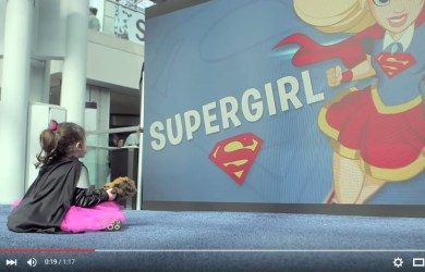 A super hero girl looks at Supergirl in the DC Super Hero Girls Sizzle Reel