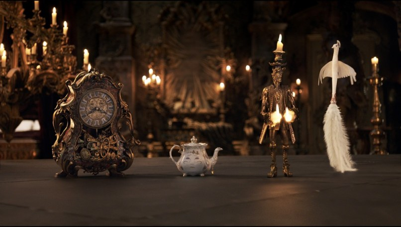 The mantel clock Cogsworth, the teapot Mrs. Potts, Lumiere the candelabra and the feather duster Plumette live in an enchanted castle in Disney's BEAUTY AND THE BEAST the live-action adaptation of the studio's animated classic directed by Bill Condon.