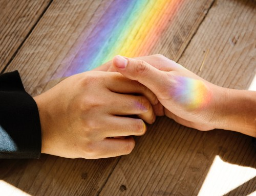Holding hands with rainbows