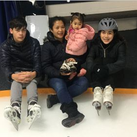 Benjamin and Lucy teaching Danielle how to skate.