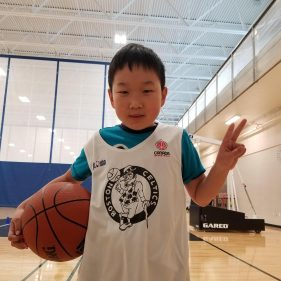 Joanny learning Basketball with Stryker Sports