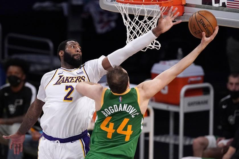 Utah Jazz forward Bojan Bogdanovic, right, shoots as Los Angeles Lakers center Andre Drummond defends during the second half of an NBA basketball game Saturday, April 17, 2021, in Los Angeles. (AP Photo/Mark J. Terrill)