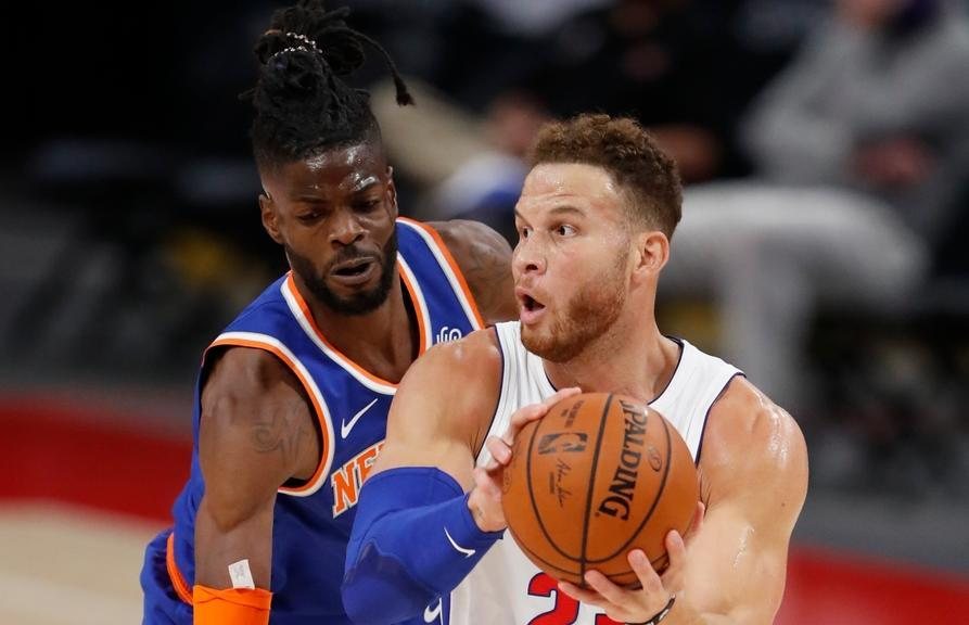 Dec 11, 2020; Detroit, Michigan, USA; Detroit Pistons forward Blake Griffin (23) is defended by New York Knicks forward Nerlens Noel (3) during the first quarter at Little Caesars Arena.