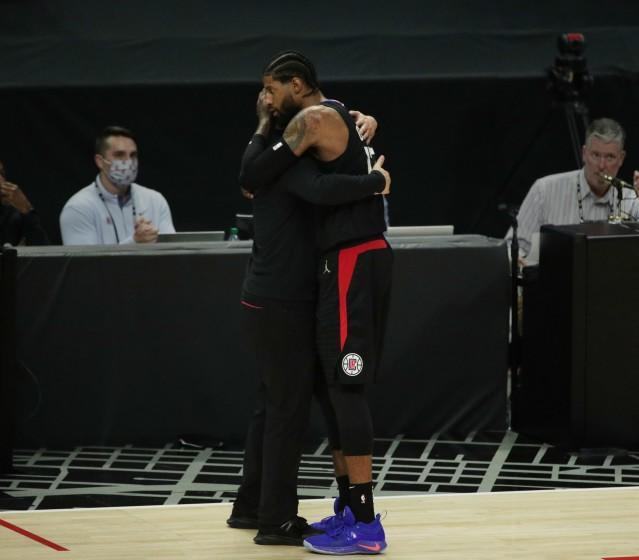 Clippers forward Paul George and coach Tyronn Lue embrace in the final moments of the season-ending loss to the Phoenix Suns.