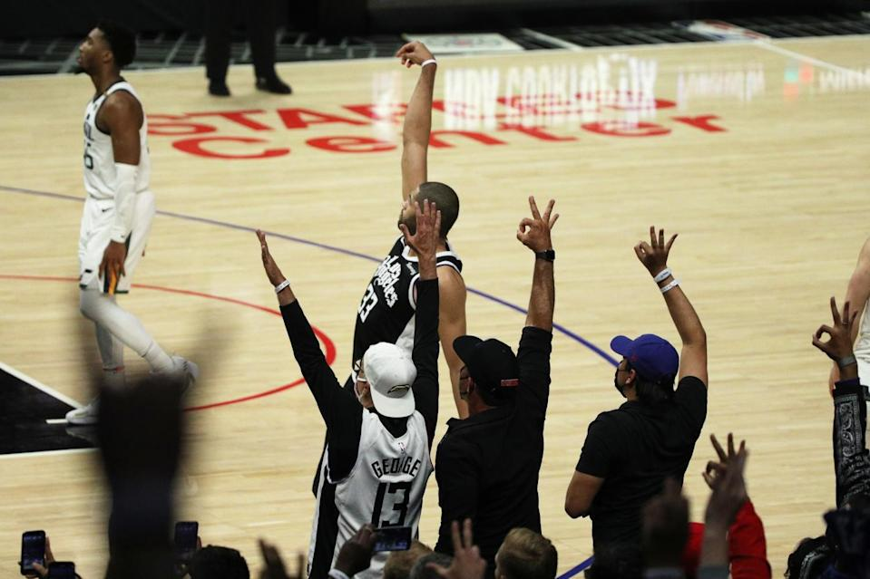 Fans react to a three-pointer by Clippers forward Nicolas Batum.