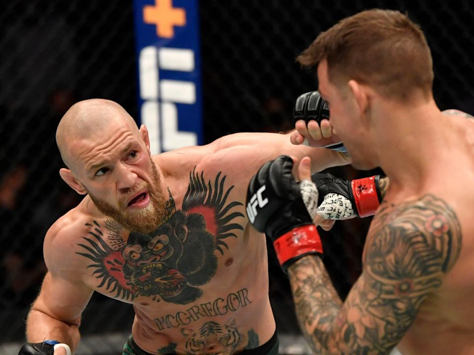 Conor McGregor was knocked out by Dustin Poirier (right) in January (Zuffa LLC via Getty Images)