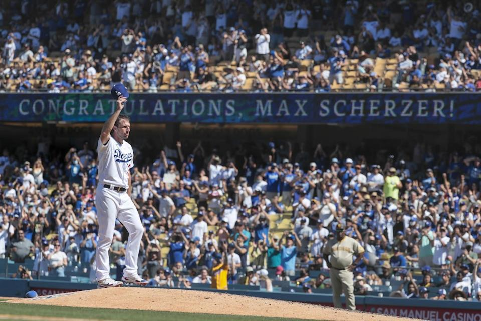 Dodgers starting pitcher Max Scherzer acknowledges a standing ovation from the fans at Dodger Stadium.